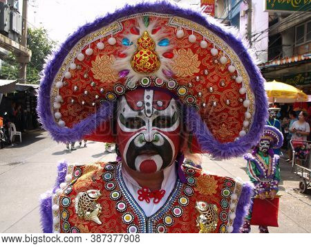Bangkok, Thailand, November 14, 2015: A Man With His Face Painted And A Colorful Dress In A Festival