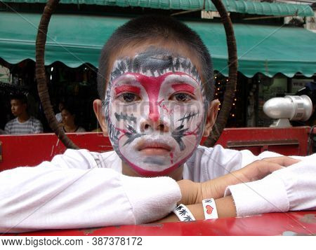 Bangkok, Thailand, November 14, 2015: A Boy With His Face Painted In A Festival Of The Clans Of The