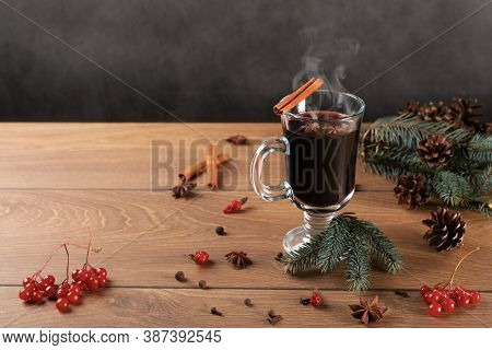 Christmas Hot Mulled Wine With Cinnamon And Anise On Wooden Background. Traditional Christmas Mulled