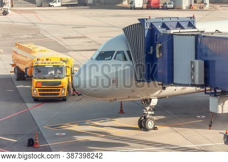 Aircraft In The Parking Lot Is Attached To The Boarding Bridge For Boarding Passengers From Terminal