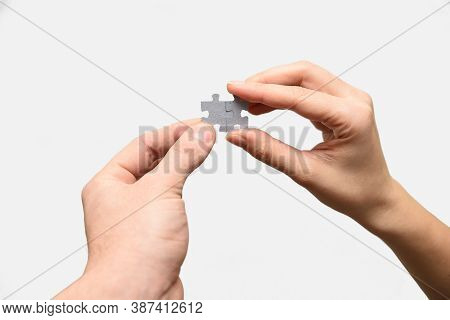 Puzzle Pieces In Hand Human. Teamwork Concept