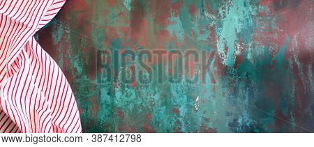 Green Background With Rusty Texture And Napkin