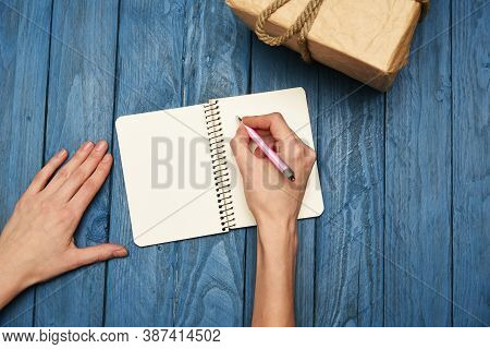 Woman Writing In Notebook Flatlay Over Head View