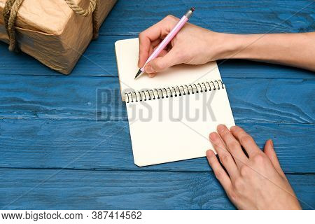 Girl Hand Close Up Writing In Notebook Top View