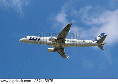 Warsaw, Poland - 29 July 2020: Polish Airlines Lot Embraer 195 Lr Jetliner On The Climbout After Tak