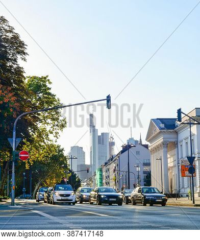 Cityscape With Modern Architecture, Green Trees And Cars Stoped At Traffic Light, Downtown Of Frankf
