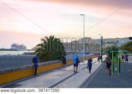 Funchal, Madeira Island, Portugal - Feb 04, 2020: People Walking By Embankment Of Funchal. Funchal I