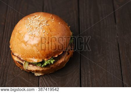 American Burger On Wood Table With Copy Space Overhead