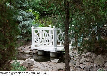 White Wooden Gazebo In A Summer Green Park. Cozy Garden Alcove To Spend Time At Nature
