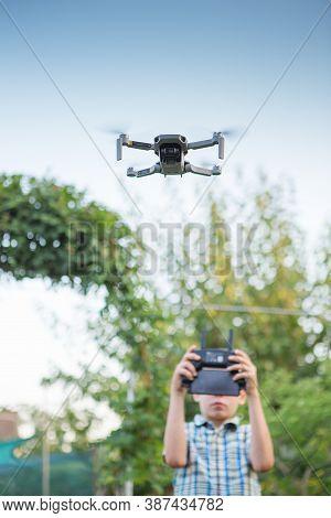 Kid Flying Drone. Boy Operate Drones