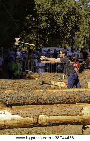 WEST POINT, CA - OCTOBER 6: Unidentified male & female competitors in the axe throwing event at the Lumberjack day, on October 6, 2012 in West Point. West Point celebrates it's 38th Lumberjack day.