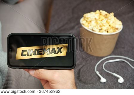 Cinemax Logo On The Mobile Phone Screen With Popcorn Box And Apple Earpods On The Background, Septem