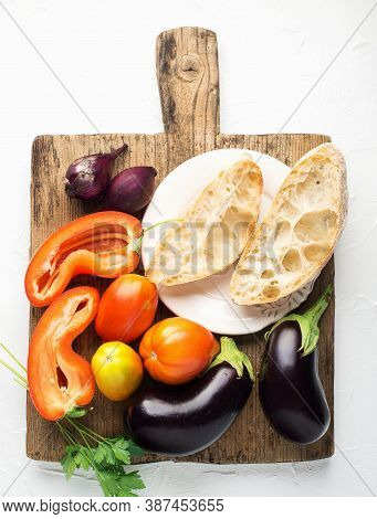 Bread Salad With Eggplants, Tomatoes, Onions, Capsicum Ingredients For Fresh Preparation. Comfortabl
