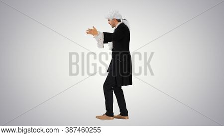 Man Dressed Like Wolfgang Amadeus Mozart Conducting An Orchestra