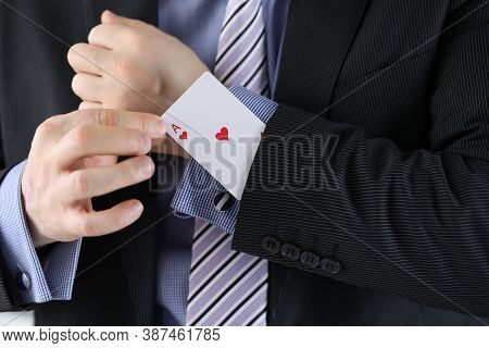 Man In Suit Puts Ace Of Chirv Card Into Sleeve Of His Jacket. Decisive Secret Business Idea Concept.