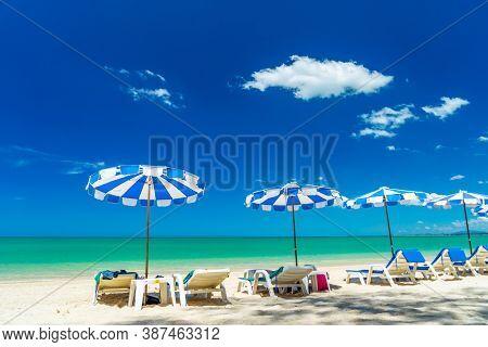 sun lounger and umbrella at White Sand Beach (Pak Weep Beach) in Khao Lak Thailand