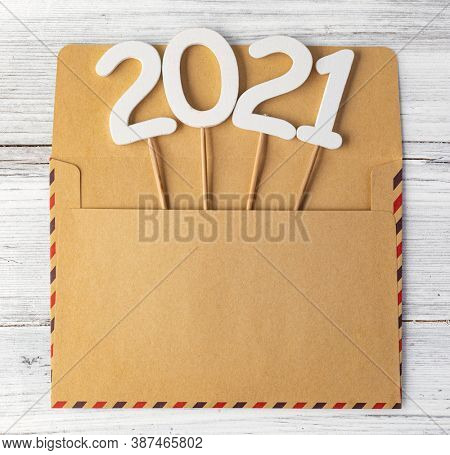 2021 year. 2021 on a wood background. new year 2021.