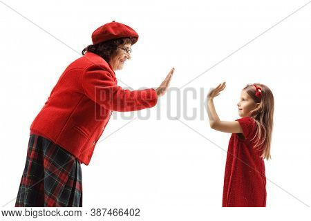 Grandmother gesturing high-five with a little girl isolated on white background