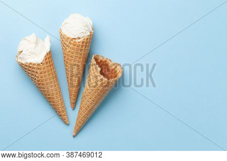 Homemade vanilla ice cream sundae and waffle cones. Top view flat lay with copy space