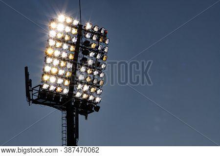 stadium lights reflector and dark blue sky
