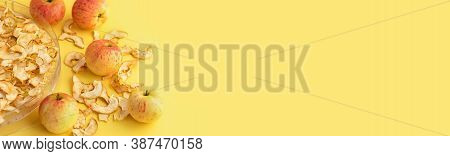 Apples And Electronic Dehydrator Dryer On A Yellow Background. Preserving Fresh Fruit By Drying. Ban