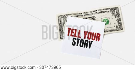 1 Dollar Bill And White Notepad Sheet On The White Background. Tell Your Story Text