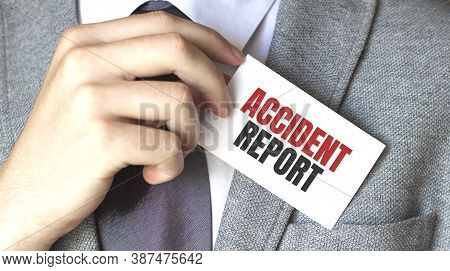 Businessman Holding A Card With Text Accident Report