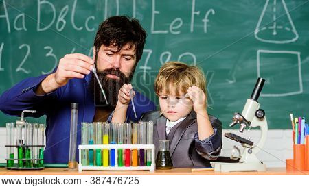 Genius Kid. Teacher Child Test Tubes. Chemical Experiment. Achieving Developmental Milestones Way Be