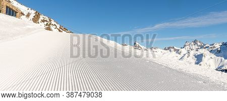 Close-up Straight Line Rows Of Freshly Prepared Groomed Ski Slope Piste With Bright Shining Sun And