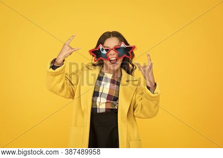 She Goes Crazy. Crazy Child Show Horns Sign Hand Gesture. Happy Girl With Crazy Look Yellow Backgrou