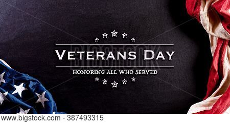 Happy Veterans Day Concept. American Flags Against Blackboard  Background. November 11. Day.