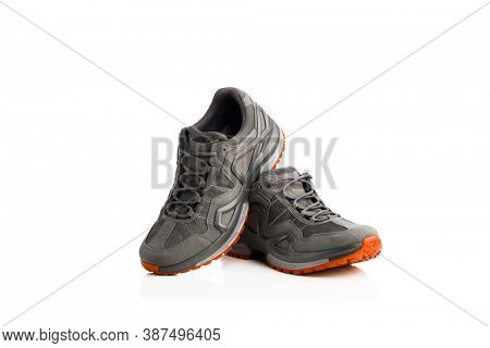 trekking sneakers with red sole, isolated on white