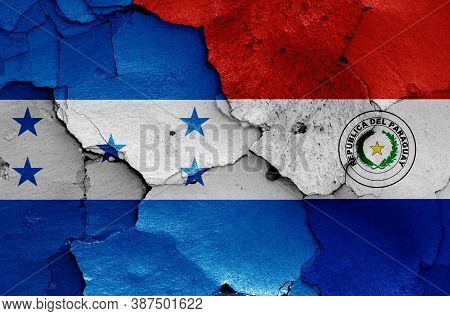 Flags Of Honduras And Paraguay Painted On Cracked Wall