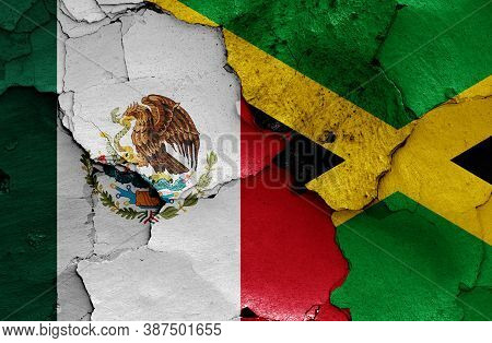 Flags Of Mexico And Jamaica Painted On Cracked Wall