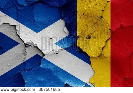 Flags Of Scotland And Romania Painted On Cracked Wall