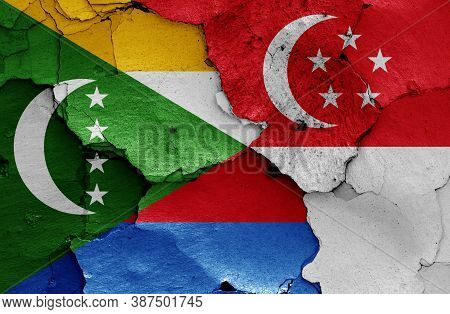Flags Of Comoros And Singapore  Painted On Cracked Wall