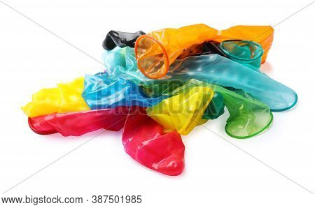 Pile Of Unrolled Bright Condoms On White Background. Safe Sex