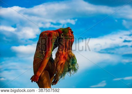 Beautiful Young Woman With Amazing Body-art Color. Color Womans Body With Colorful Holi Splash. Abst