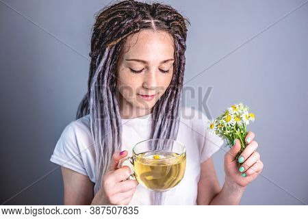 Woman Is Drinking A Hot Healthy Chamomile Tea. Concept Of Enjoying A Soothing Herbal Tea After A Dif