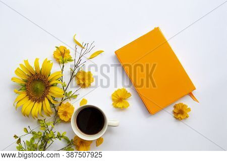 Notebook Planner For Business Work With Hot Drinks Cocoa And Yellow Flowers Cosmos, Sunfloers  Arran