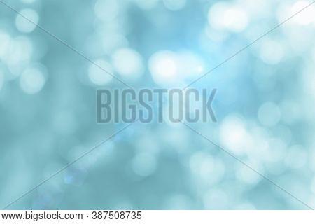 Natural Spring Blurred Blue Sea Background. Create Light Soft Blurred Colors Bright Sunshine. Blue B