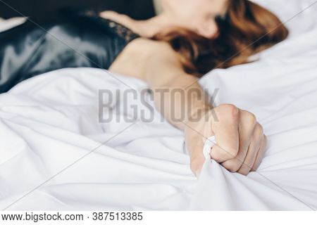 Cropped Shot View Of Woman Lying On The Bed And Do Something With Her Partner, Her Hand Pulling And
