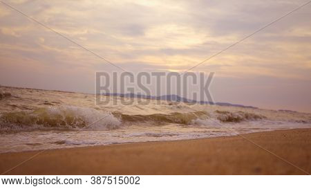 Sea Surface With Small Waves Against The Backdrop Of Sunrise Of Sun Slow Motion. Large Disk Of Sun R