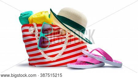 Striped Red White Beach Bag With Towel Sunglasses Flip-flops And Hat Isolated On White Background