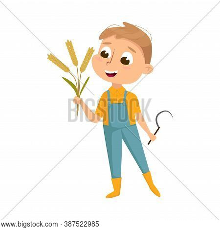 Cute Boy Holding Sickle And Sheaf Of Spikelets In His Hands, Kid Farmer Character In Overalls Workin