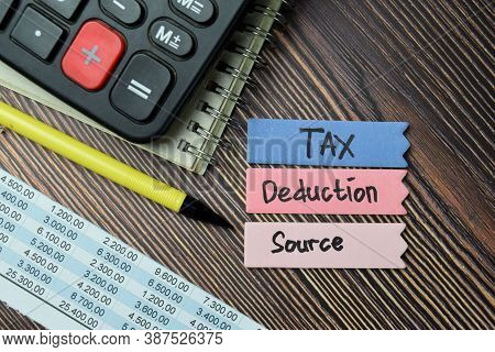Tax Deduction Source Write On Sticky Notes Isolated On Office Desk.