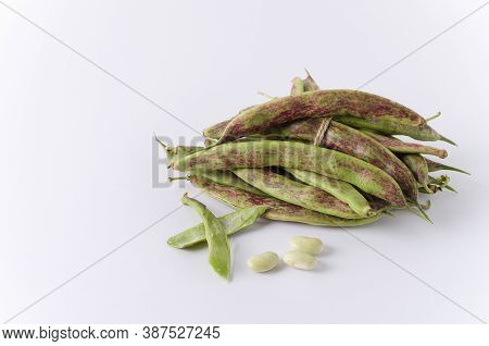 Green Beans Pods Tied With Jute Lie On A White Background. Copy Space, Space For Text,