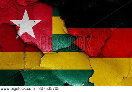 Flags Of Togo And Germany Painted On Cracked Wall