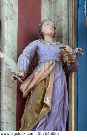 PREPOLNO, CROATIA - JULY 01, 2013: Saint Apollonia, statue on the altar of Saint Barbara in Our Lady of Sorrows Chapel in Prepolno, Croatia