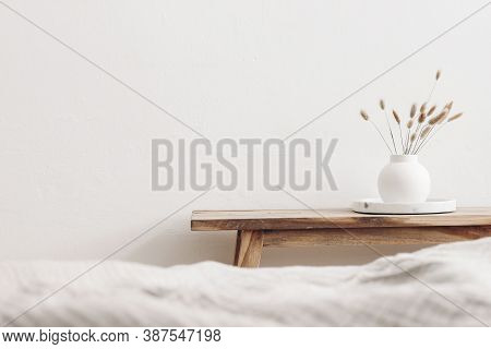 Modern White Ceramic Vase With Dry Lagurus Ovatus Grass And Marble Tray On Vintage Wooden Bench, Tab